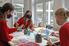 Children painting spring or Easter cards to raise money for the charity The Red Hen Project